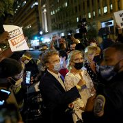 Protesters surround Senator Rand Paul of Kentucky and his wife as they left the Republican National Convention late Thursday. He said he was attacked by an