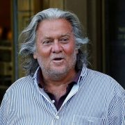 Bannon (pictured being released from custody on August 20) will go to trial in May