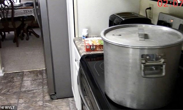 A stockpot containing Lisa Guy's severed head is seen boiling on the stove after her murder
