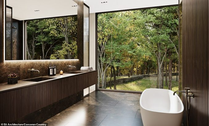MASTER BATHROOM: Even this comes with a floor-to-ceiling window overlooking some of the trees in the huge gardens