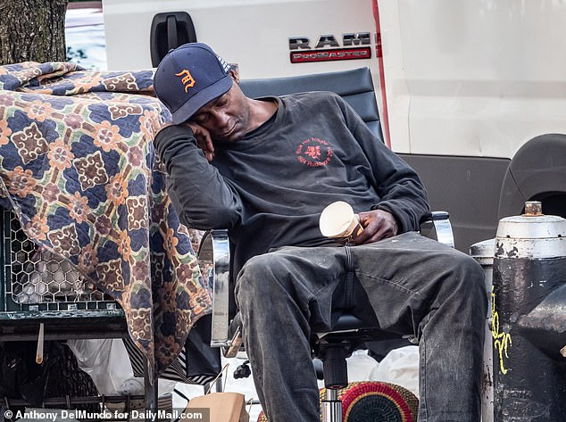 A homeless man sleeps on a chair at the corner of W 80th Street and Broadway in the Upper West Side on September 3