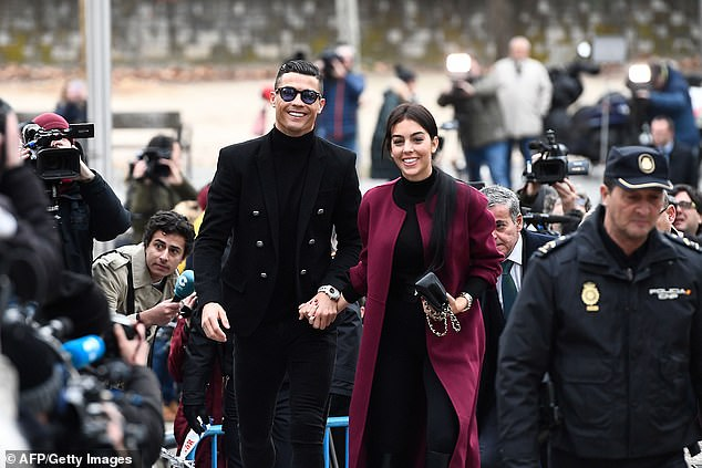 Cristiano Ronaldo with his girlfriend Georgina Rodriguez last year, who has backed him over the rape claims, pictured in Madrid together last year