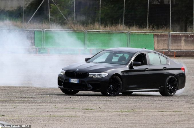 Put your foot down! Tom showed off his impressive driving skills in a black BMW and executed perfect spins in the fancy car
