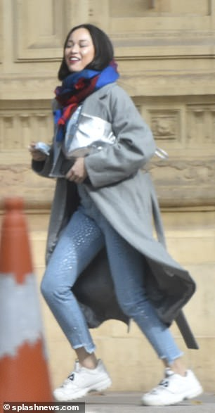Dressed to impress: She was wrapped up in a double denim ensemble, teamed with a grey mac and a colourful tartan scarf wrapped around her neck