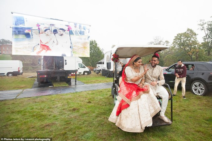 Another 300 guests from all over the world also watched the live footage of the couple saying their vows at Braxted Park, a stunning country house in Chelmsford, Essex, via video link