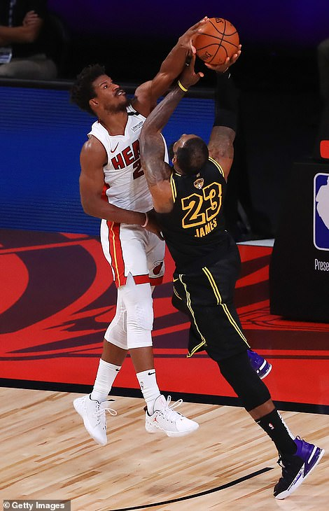 Jimmy Butler (left) had a 35-point triple-double in Game 5 and came up with a clutch block on LeBron James (pictured)