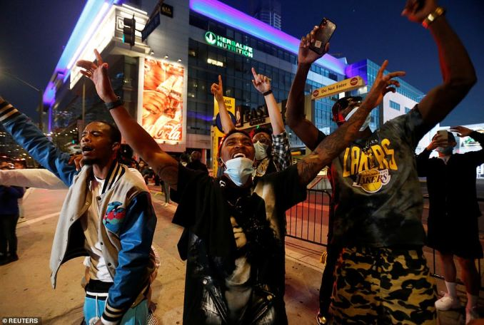Lakers fans celebrate near Staples Centers as Los Angeles plays against Miami Heat in Game 6 of the 2020 NBA Finals