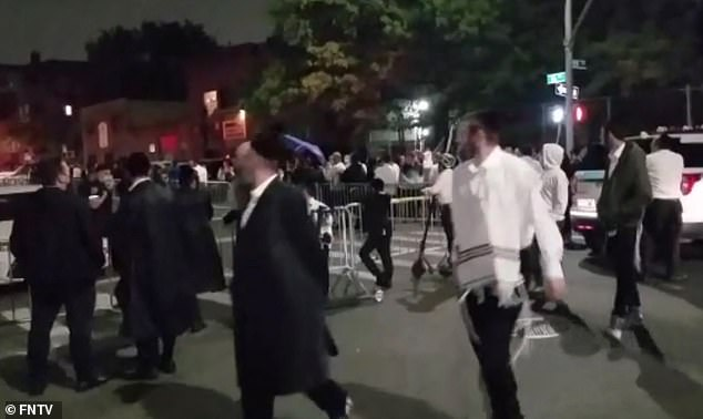 Protests on Sunday night where at least one person demanded to 'defund de Blasio' amid a row between city authorities and Orthodox Jewish communities over coronavirus rules