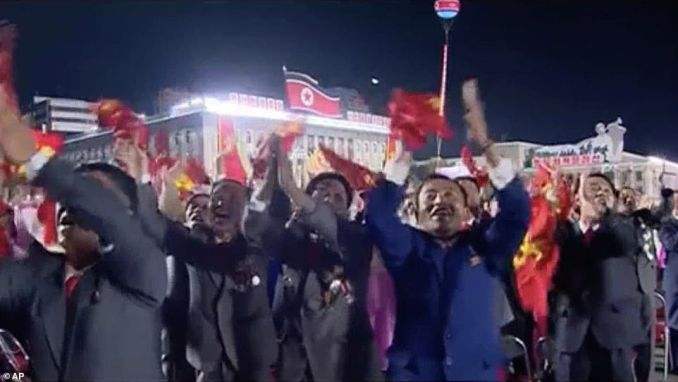 Crowds of North Koreans cheer as the North Korean leader Kim Jong Un enters to make a speech for the ruling party's 75th anniversary
