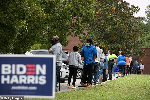 People stand in line on the first day of early voting for the general election at the C.T. Martin Natatorium and Recreation Center in Atlanta, Georgia