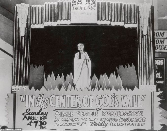 In 1937, a long time follower of McPherson's named Rheba Crawford (also known as the 'Angel of Broadway') filed a slander lawsuit against McPherson for $1,080,000. Crawford alleged that Mcpherson called her a 'jezebel' and Judas' and accused her of of attempting to takeover the Temple. Above, a sign at the Angelus Temple announces she will discuss with her faithful flock the pending lawsuit