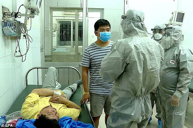 More than 20% in Mexico believe the pandemic is 'part of a plot to enforce global vaccination' in addition to 18% in the US and 13% in the UK. Pictured:Officials from Vietnam's Ministry of Health speak with two men who tested positive for the coronavirus, January 2020