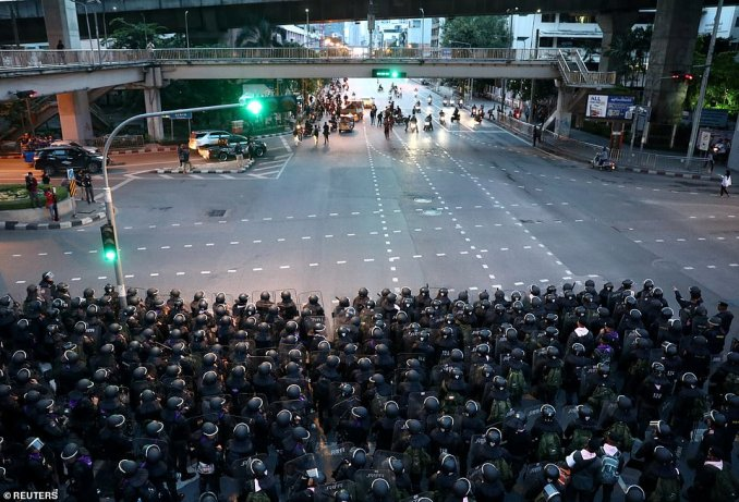 Shortly after the emergency decree took affect at 4 a.m. (2100 GMT), riot police advanced behind shields on protesters who had camped outside Government House in Bangkok (pictured)