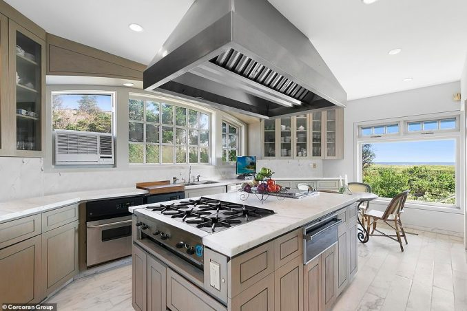 The Hamptons, New York home also has a two-car garage and studio apartment. Pictured is the kitchen with ample work space