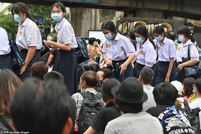 Schoolchildren appeared to be joining the protest in Bangkok as they arrived still wearing their uniforms