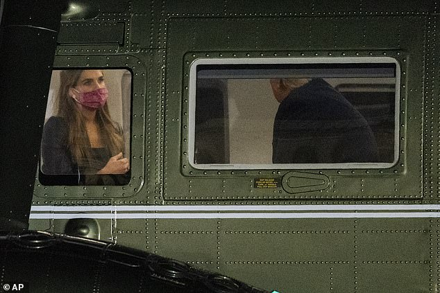 Hope Hicks wears a face mask aboard Marine One in mid-September