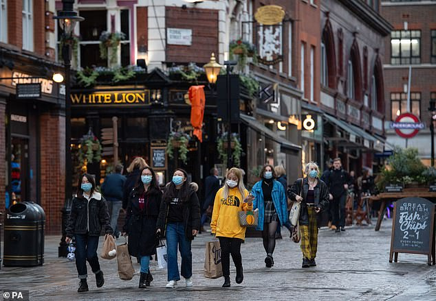 Patrick Dardis: When pubs were allowed to reopen in July, we estimated cautiously that about 5,000 pubs would not survive. Pictured:People wearing face masks in Covent Garden in central London walk past the White Lion pub