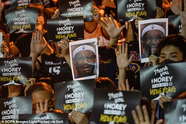 Protesters in Hong Kong slam LeBron James for his perceived submission to the Chinese regime, while many hold up signs thanking then-Rockets GM Daryl Morey for his support