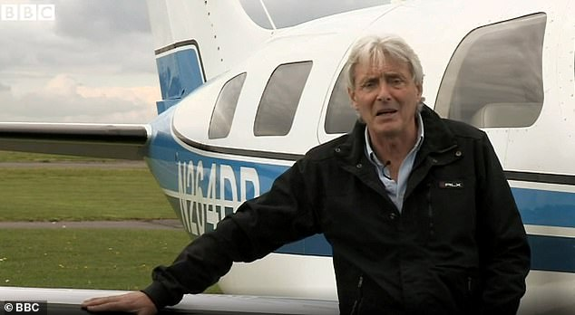 David Henderson (pictured with the doomed plane) was arrested on suspicion of the manslaughter of Emiliano Sala and David Ibbotson