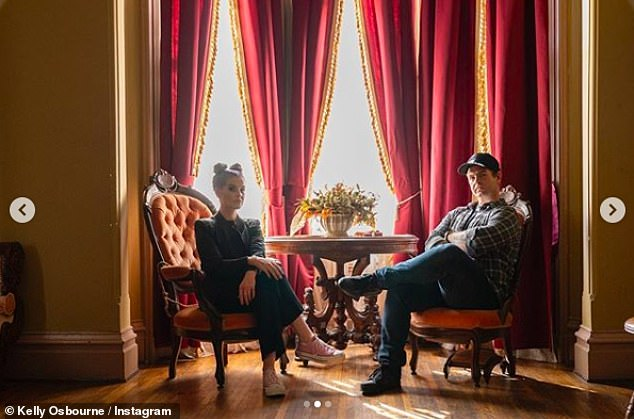Family:In another photo, Kelly sat with her brother as they prepared to go 'ghost hunting' for Halloween in a segment recorded for the Travel Channel