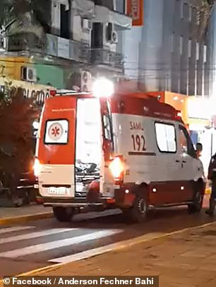 The cute pup can be seen being let into the ambulance to be by her owner's side
