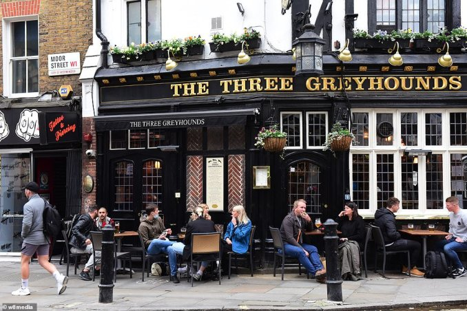 People gearing up for a busy night of drinking and eating in soho, London. The sale of outside heaters has skyrocketed as pub owners hope to turn their car parks into seating