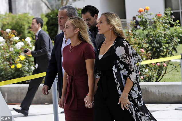 Carli Skaggs, center in burgundy dress, walks into St. Monica Catholic Church for a memorial for her husband, Los Angeles Angels pitcher Tyler Skaggs on July 22, 2019