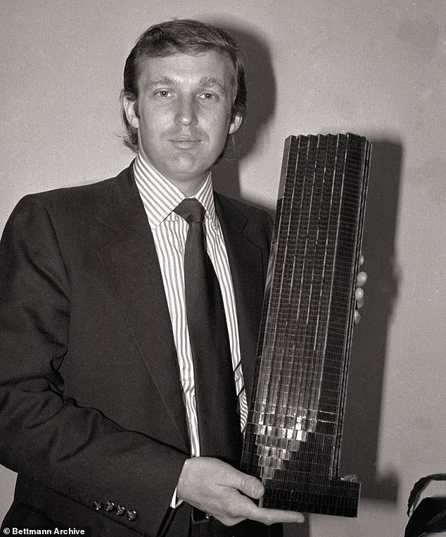 Trump in 1980 holding a model of Trump Tower.Res claims he once raged at her for having black construction workers building Trump Tower and told her to 'get him [a black man] off there right now'