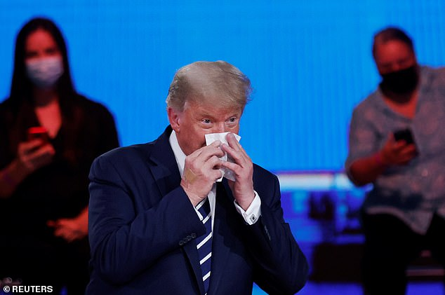 Pictured:U.S. President Donald Trump touches his nose part during a live one-hour NBC News town hall forum with a group of Florida voters in Miami,
