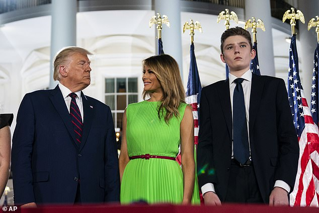 Melania Trump (center) revealed this week that her and Trump's 14-year-old son, Barron (right), contracted COVID-19