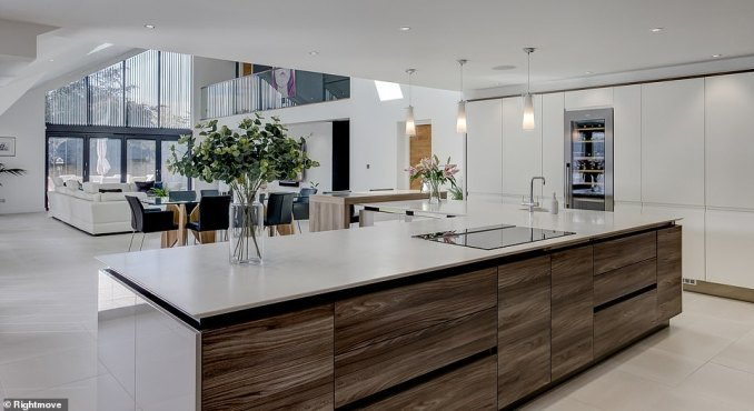 Priced at £1.1million, the minimalist abode boasts four spacious bedrooms and stylish open-plan living spaces which open out onto the garden thanks to sliding floor-to-ceiling patio doors