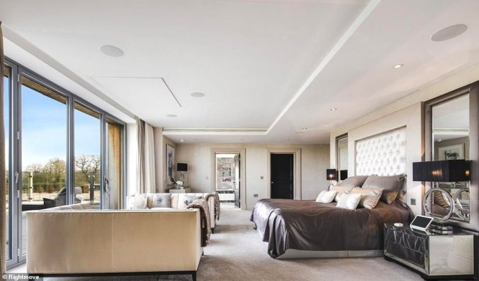 On the design side of things, the home's interiors are magazine-worthy, with swathes of marble, natural stone and glass accompanied by a largely monochrome colour scheme