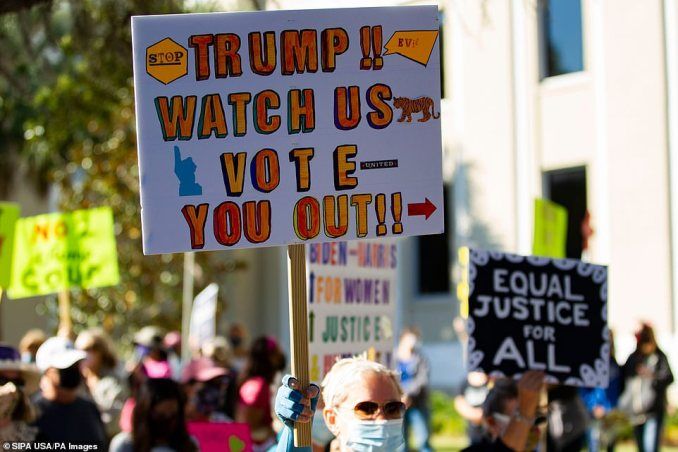 'Trump! Watch us vote you out,' one Tallahassee protester's sign reads on Saturday
