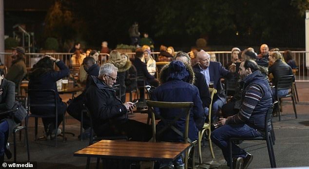 Tables were filled in Borough Market as people donned coats and scarves in order to sit outside with members of other households in London today