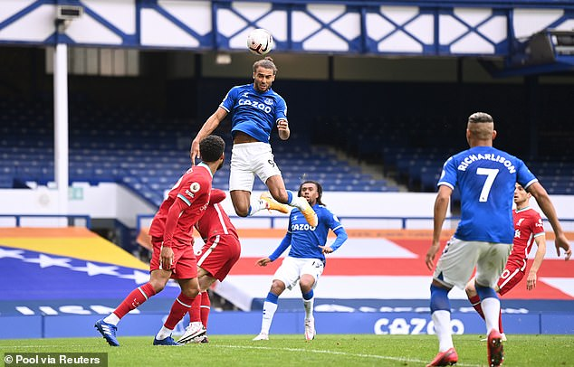 Today: Everton'sDominic Calvert-Lewin scores their second goal in the Merseyside derby in front of an empty stand