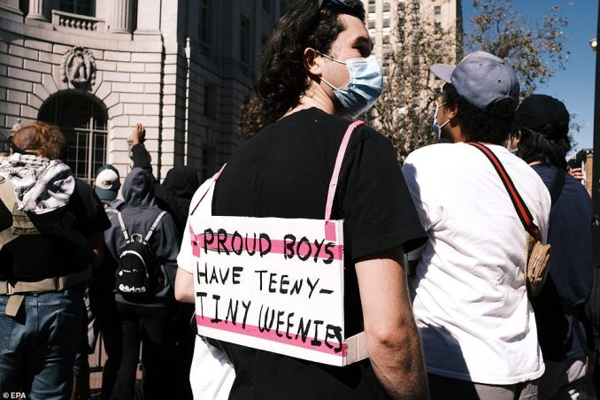 A counterprotester wore a sign mocking Proud Boys as they were expected to attend the event