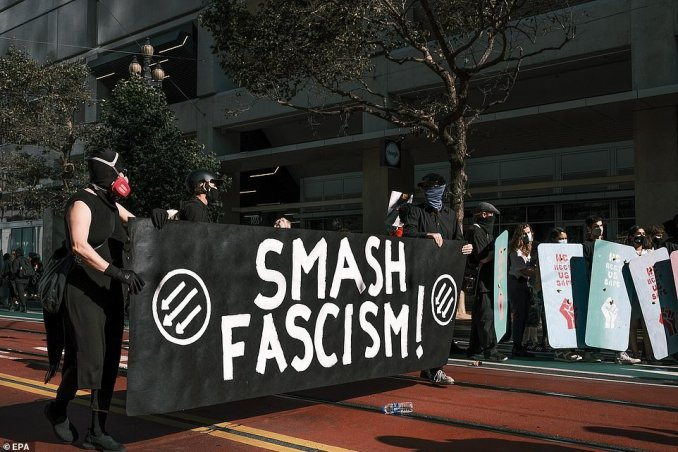 Some counterprotesters held up a 'Smash fascism' sign at the event and are dressed head to toe in black