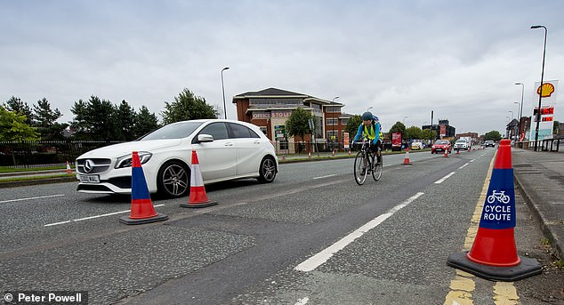 Across the country, councils have started receiving funding from a total £250 million pot of money to spend on cycling, to get people fit and out of their cars as part of the war on coronavirus. Pictured: A new cycle lane on the A56, Sale, Manchester