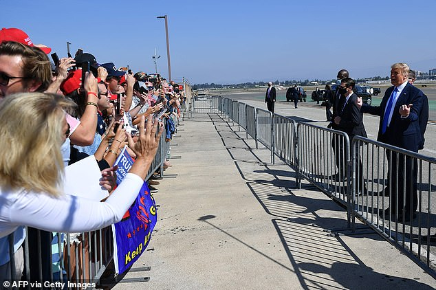 President Donald Trump took a few minutes to greet supporters at the John Wayne Airport Sunday before attending a closed door fundraiser