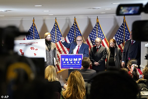 Rudy Giuliani was surrounded by a maskless group on stage including from left Sidney Powell, who is Mike Flynn's attorney, Joseph diGenova and his wife Victoria Toensing, a husband-and-wife lawyer team who have promoted conspiracy theories, and Boris Epshteyn, a Trump aide