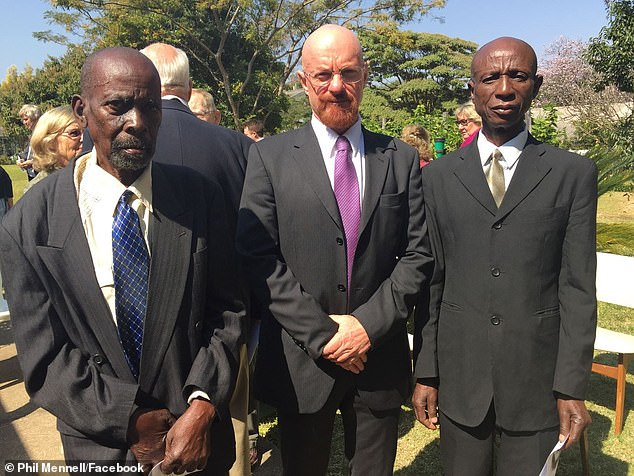 Mr Mennell with family friends in Zimbabwe in 2015. The mechanical engineermoved to Australia in 2003 and says he 'identifies with the character Walter White' because he went though his own midlife crisis upon emigrating