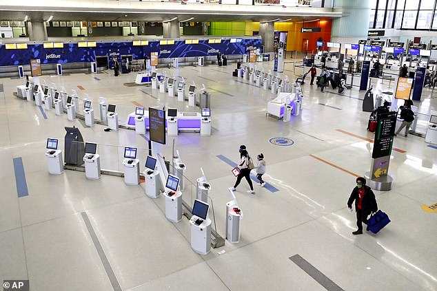 Last year, between the Wednesday before Thanksgiving and the Sunday after, 4.58 million people flew. In 2020, an estimated 2.4 million people are expected to fly, which would be the largest one-year decrease on record. Pictured: Travelers walk through the nearly empty JetBlue terminal at Logan Airport, November 20