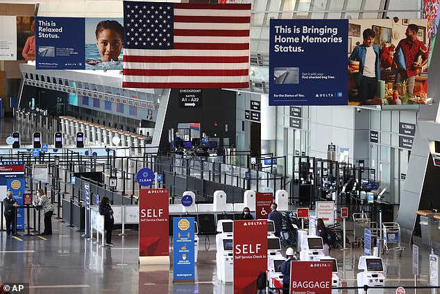 Several airlines warned that they expect more cancelations in the coming weeks. Pictured:An American flag hangs over the nearly empty Delta terminal at Logan Airport, November 20