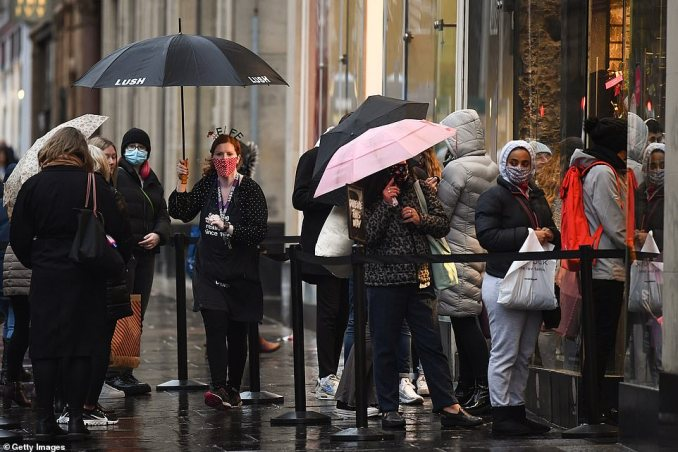 Members of the public do some last-minute shopping at Lush in Glasgow this afternoon