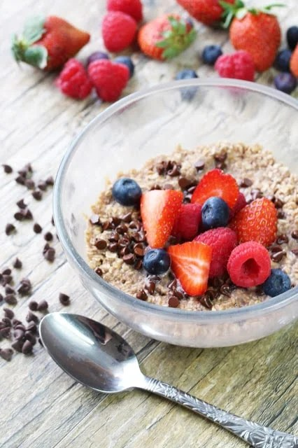 Oatmeal made with chocolate milk and topped with fresh berries. It's an easy and delicious breakfast!
