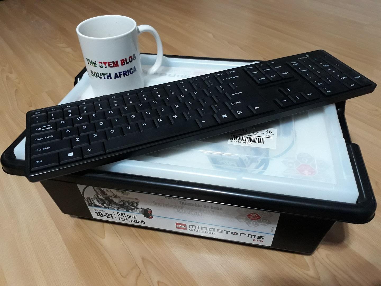 Lego Mindstorms EV3 core set with coffee mug and keyboard