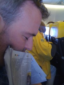 Ross aka the stented papa sleeping on a plane leaning on his newspaper
