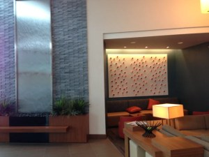 Lobby with water wall and seating area