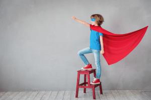 School pupil in superhero pose