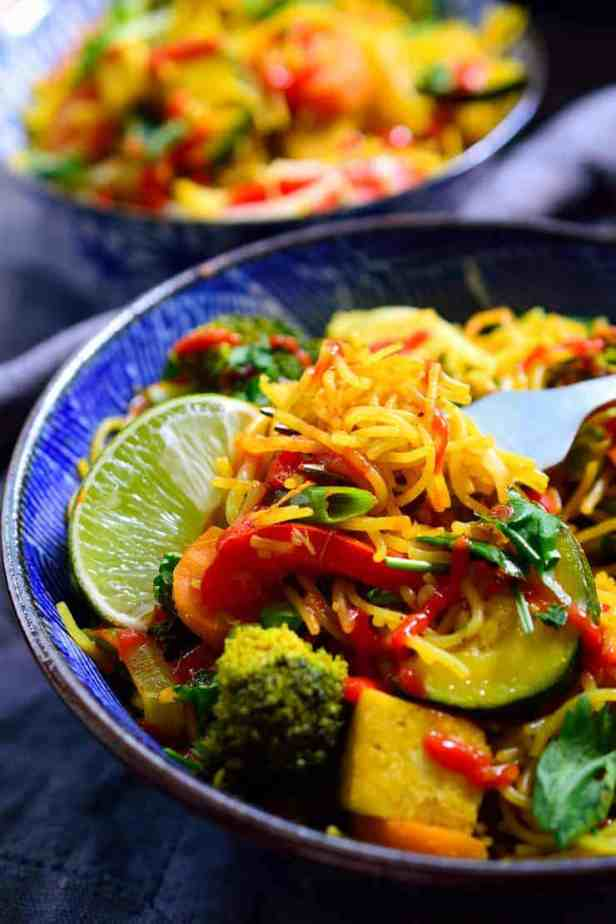 Vegetable Singapore noodles are super easy to make with curried rice vermicelli, pan-seared tofu and a rainbow of veggies. A quick and easy dish perfect for a weeknight dinner!